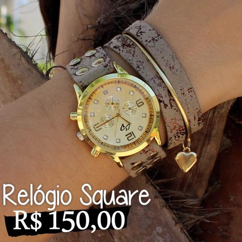 Relógio Square - Relógio customizado, com pulseira de couro sintético na cor caqui com detalhes craquelados e pingente de coração. Banho dourado e fechamento em botão de pressão, com duas opções de ajuste de comprimento. Garantia: 1 ano pelo fabricante. Comprimento 21cm e Largura 4cm.
